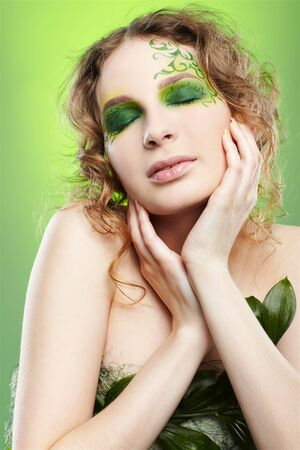 portrait of beautiful girl with fairy theme bodyart posing on green Stock Photo - 7468677
