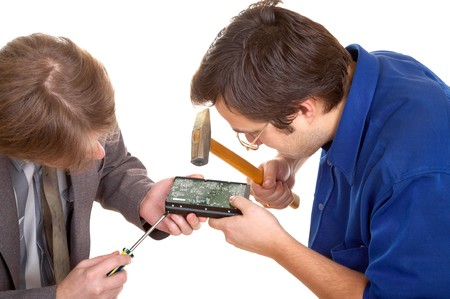fixed disk: Two men repairing hard drive on white background Stock Photo