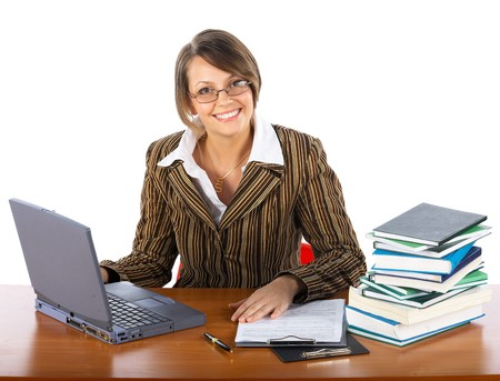 businesswoman with laptop and books seating at the table photo