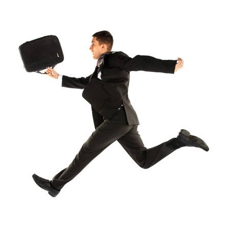 jumping young manager in suit on white photo