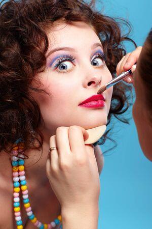 esthetician: portrait of beautiful curly brunette girl make up