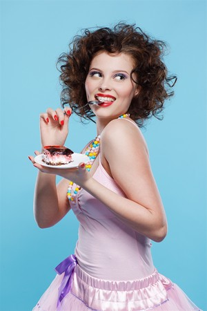 portrait of beautiful curly brunette girl with cake Stock Photo - 7486439
