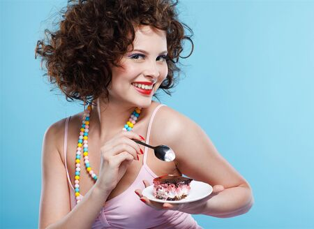 portrait of beautiful curly brunette girl with cake Stock Photo - 7486404