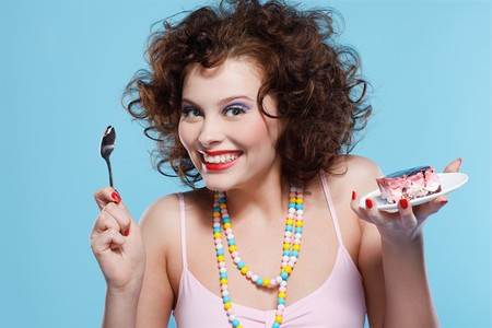 portrait of beautiful curly brunette girl with cake Stock Photo - 7486402