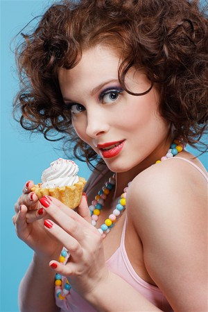 portrait of beautiful curly brunette girl with tart Stock Photo - 7486495