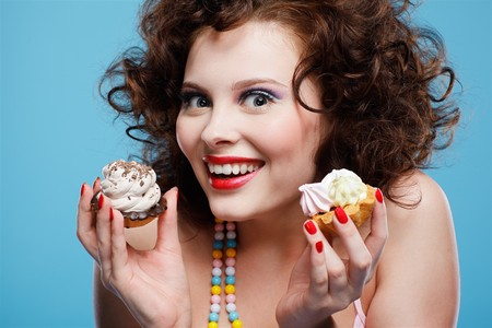 portrait of beautiful curly brunette girl with two tarts Stock Photo - 7486491