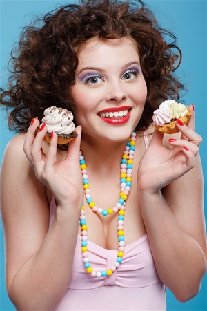 portrait of beautiful curly brunette girl with two tarts Stock Photo - 7486494