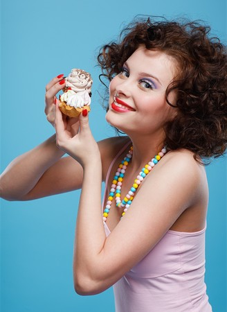 portrait of beautiful curly brunette girl with two tarts Stock Photo - 7486475