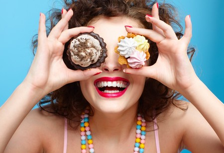 tart: portrait of beautiful curly brunette girl with two tarts Stock Photo