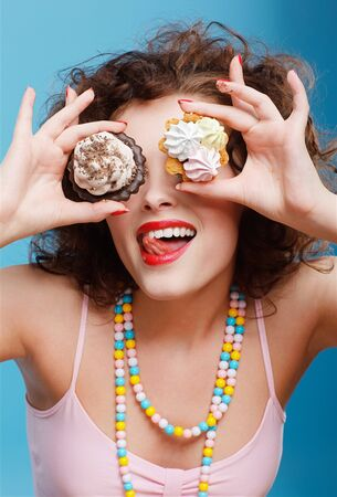 portrait of beautiful curly brunette girl with two tarts Stock Photo - 7486472