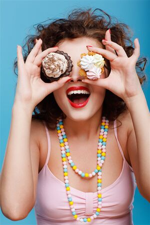 portrait of beautiful curly brunette girl with two tarts Stock Photo - 7486477