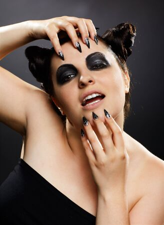 portrait of brunette girl with cat-theme make-up photo
