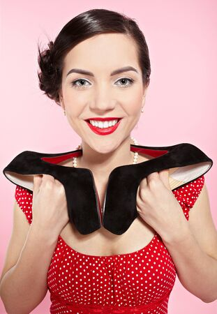 court shoes: pin-up style portrait of beautiful brunette girl posing with court shoes