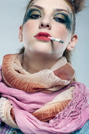 punk hair: portrait of glam punk redhead girl smoking cigarette