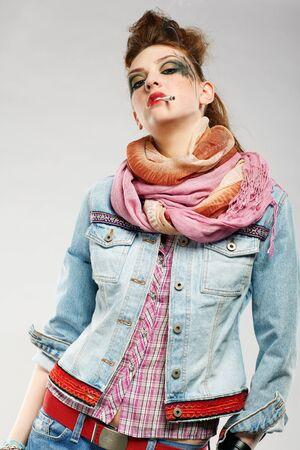portrait of glam punk redhead girl smoking cigarette photo