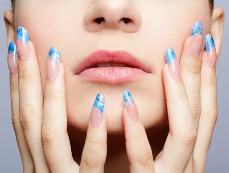close-up portrait of girls lower part of face and manicured fingers Stock Photo
