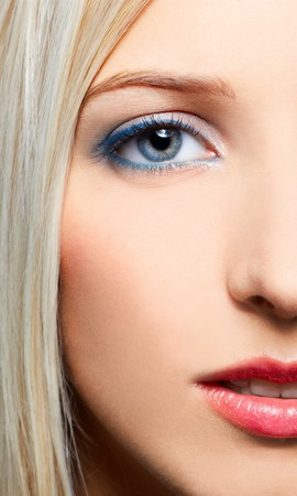 close up half-face portrait of beautiful blonde girl photo