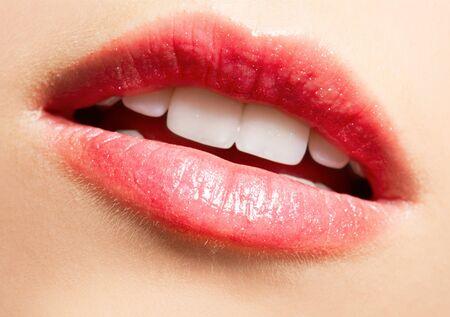 close-up portrait of beautiful girls lips-zone make-up