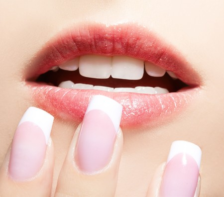 close-up portrait of beautiful girls manicure and lips-zone make-up photo