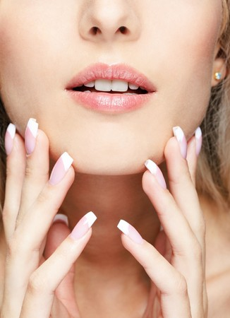 close-up portrait of beautiful girl's lower part of face and manicured fingers Stock Photo - 7767924