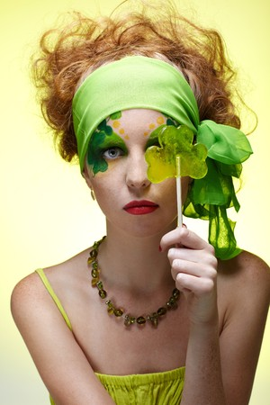 portrait of beautiful red-haired model with shamrock body art photo