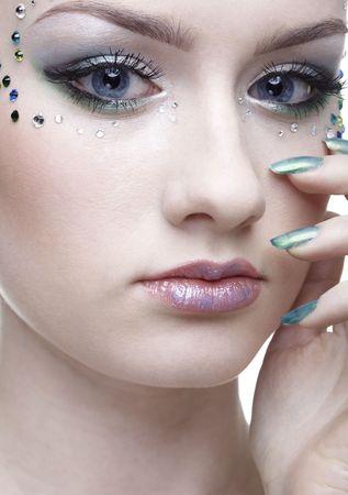 portrait of beautiful girl with mermaid bodyart photo