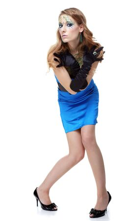 portrait of beautiful girl with bodyart of algae posing in blue dress with wide black belt and black gloves photo