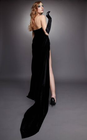 portrait of beautiful girl with bodyart of algae posing in long black dress photo