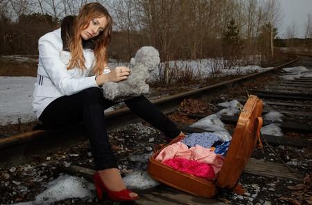 Blonde girl sitting on rail photo