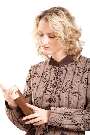 Blonde student girl reading a book on white background photo