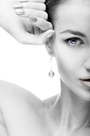 close-up portrait of beautiful blue eyed caucasian model on white photo