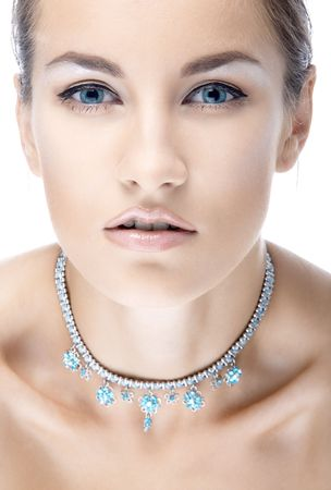 beautiful caucasian blue eyed model in necklace photo