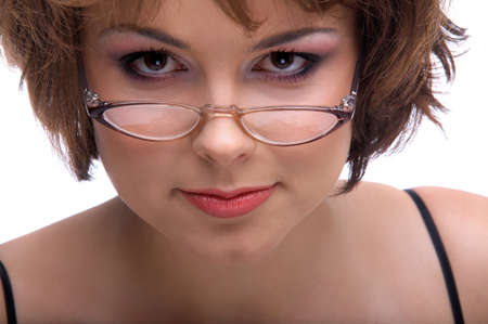 close-up portrait of brunette model in glasses poses on white photo