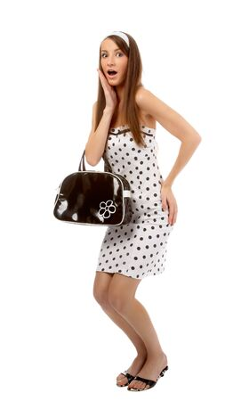 beautiful model poses in polka-dot dress with black bag looks shocked Stock Photo - 8147154