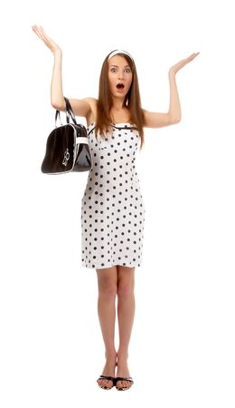 beautiful model poses in polka-dot dress with black bag looks shocked Stock Photo - 8147175