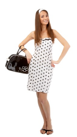 beautiful cheerful model poses in polka-dot dress with black bag on white Stock Photo - 8147164