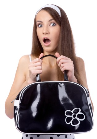 beautiful model poses in polka-dot dress holds black bag at her chest and looks shocked Stock Photo - 8147391