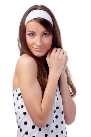 beautiful dreamy model poses in polka-dot dress on white photo