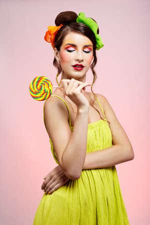 portrait of beautiful girl with big lollipop photo