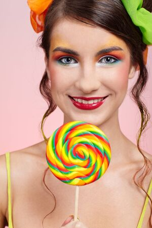portrait of beautiful girl with big lollipop Stock Photo - 8147479