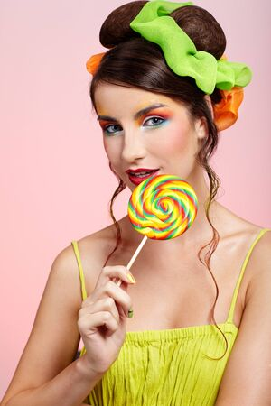 portrait of beautiful girl with big lollipop Stock Photo - 8147470