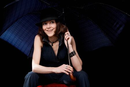 Woman with umbrella isolated on the black background photo