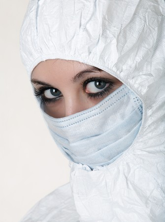 Woman dressed in white operating coat  with mask  photo