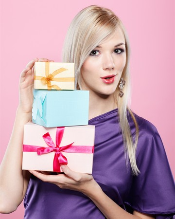 portrait of beautiful blonde party girl with birthday gift box on pink photo