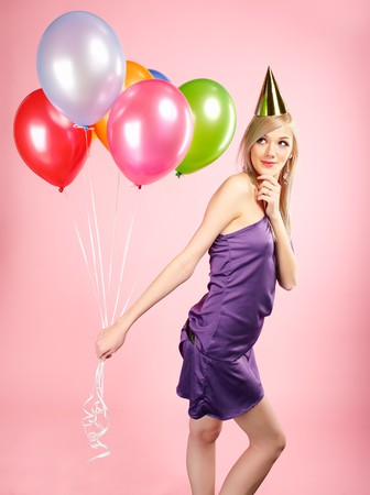 party balloons: portrait of beautiful blonde party girl with balloons on pink Stock Photo