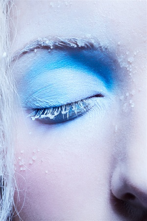 close-up portrait of beautiful girls eye-zone fantasy snow make-up photo