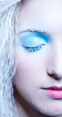 close-up portrait of beautiful frozen fairy nymph girl photo