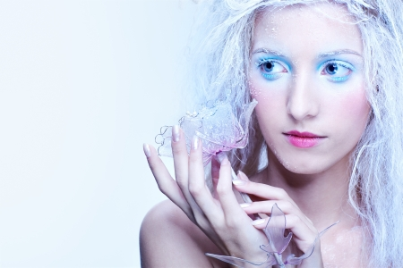 nymph: portrait of beautiful blonde frozen fairy girl with glass rose Stock Photo