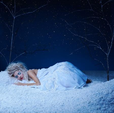 sleeping girl: portrait of beautiful frozen fairy nymph girl sleeping on snow