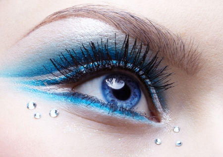 body paint: woman eye zone make-up in blue and white tone